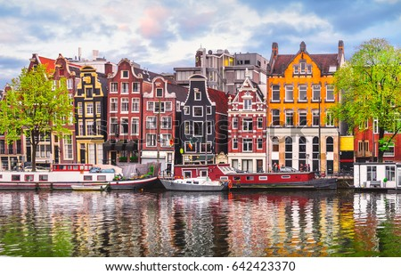Amsterdam Netherlands dancing houses over river Amstel landmark in old european city spring landscape. #642423370
