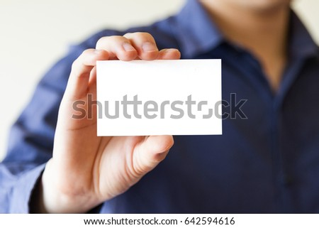 business man holding white business name card - clipping mask inside #642594616