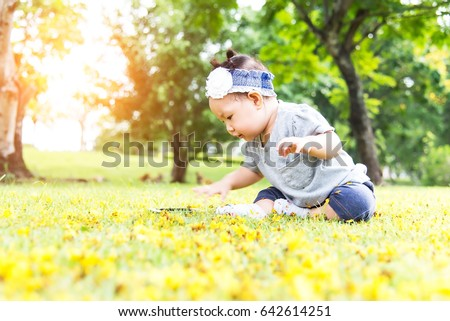 Closeup of cute adorable baby girl in grass #642614251