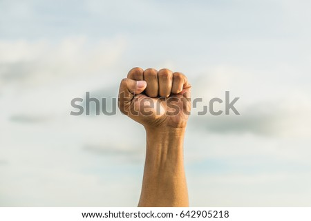 fist with sky background hand sign language #642905218