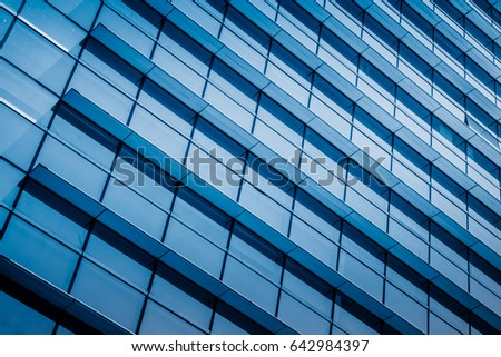 closeup of glass wall of modern building #642984397