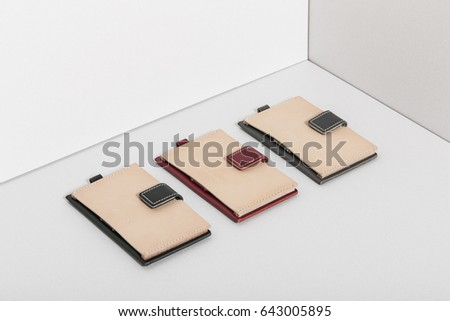 three leather case(pocket) for employee ID card, credit card on the grey background. #643005895