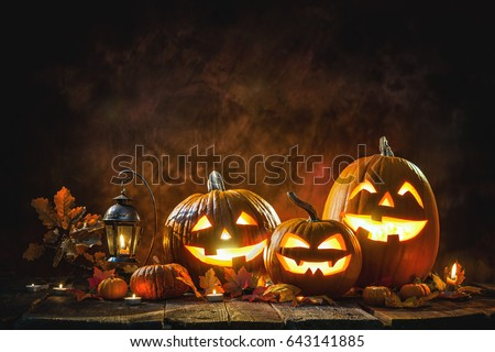 Halloween pumpkin head jack lantern with burning candles Royalty-Free Stock Photo #643141885