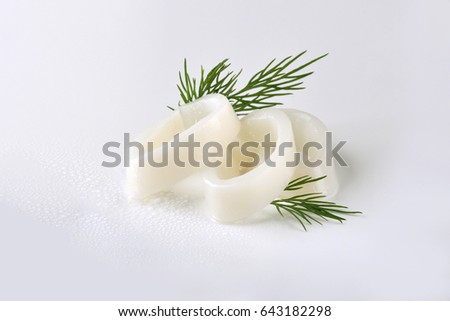 Squid rings with dill. Fresh seafood