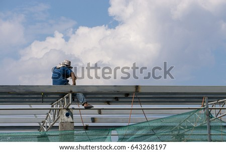 In the construction site, the welding workers at work., worker weld metal in factory and sparks. #643268197