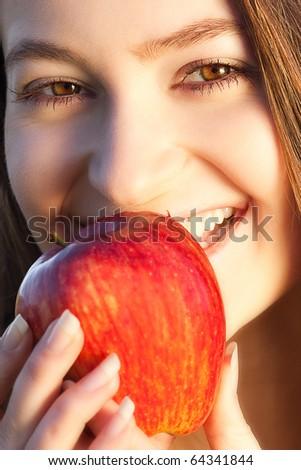 portrait of beautiful teenager women outdoor with apple #64341844