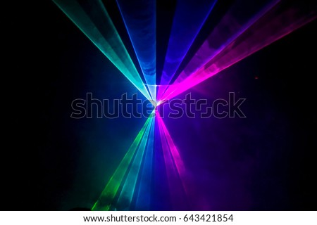 Lights show. Lazer show. Night club dj party people enjoy of music dancing sound with colorful light. club night light dj party club. With Smoke Machine and lights.  #643421854