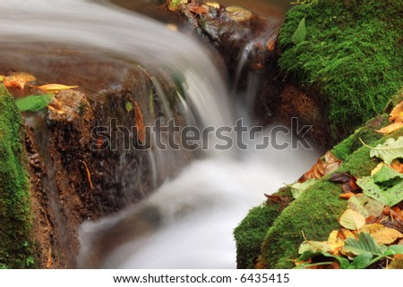 An image of little waterfall amongst stones #6435415