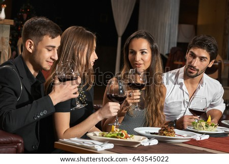 Friends having a nice dinner in a restaurant together #643545022