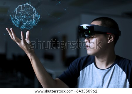 Young men playing magic | Virtual reality with hololens glasses Royalty-Free Stock Photo #643550962