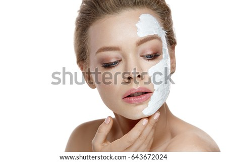 Skin Care. Portrait Of Sexy Girl With Soft Skin, Natural Makeup And Cosmetic White Mask On Facial Skin. Closeup Of Beautiful Young Woman Applying Clay Mask On Face. Beauty Cosmetics. High Resolution #643672024