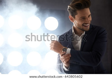 Cheerful young model in the night club #643805602