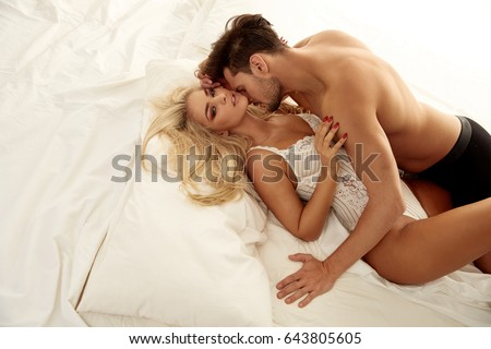 Portrait of a handsome young man seducing his lovely girlfriend #643805605