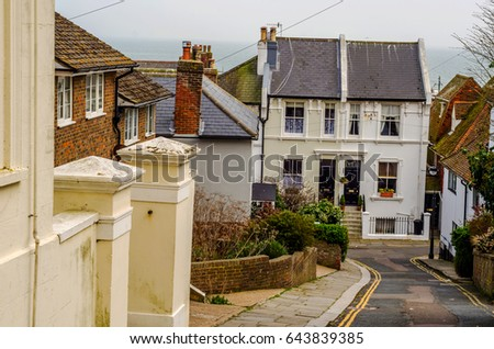 Typical English architecture, residential buildings in a row along the street, seaside town #643839385