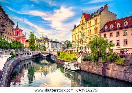 Cityscape view on Ljubljanica river canal in Ljubljana old town. Ljubljana is the capital of Slovenia and famous european tourist destination. #643916275