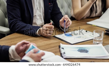 Business people partners discussing in meeting (conference) documents and ideas in a modern office #644026474