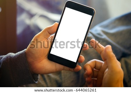 Man holding smart phone with blurred background.  For Graphic display montage. #644065261