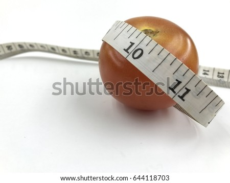 the weight management concept of tomatoes and measuring tape.   #644118703