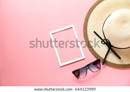 Panama hats,White picture frame and sunglasses on Pink background,copy space,Top view,flat lay