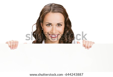 Happy young businesswoman showing signboard, with blank copyspace area for slogan, advertisiment or text message, isolated against white background. Success in business concept studio shot.  #644243887
