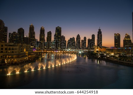 DUBAI UAE 31 JANUARY 2017 famous musical fountain in Dubai with skyscrapers in the background on a beautiful summer evening #644254918