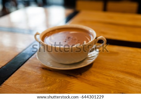 White coffee mug lay on wooden background. #644301229