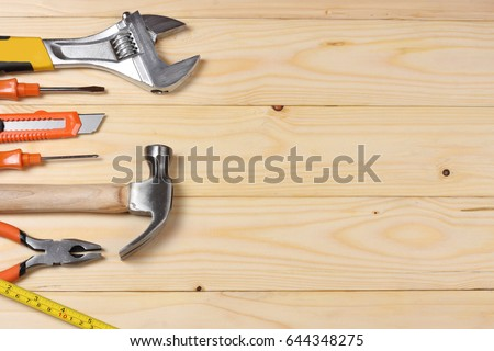industrial tools on light wooden background with copy space. top view. tools texture. tools background #644348275