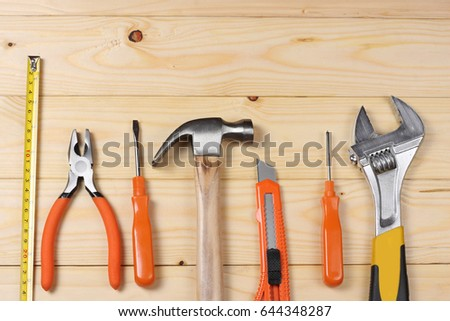 industrial tools on light wooden background with copy space. top view. tools texture. tools background #644348287