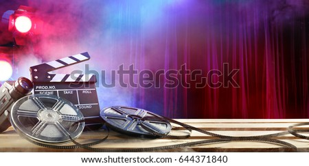 Film movie Background - Clapperboard And Film Reels In Theater  #644371840