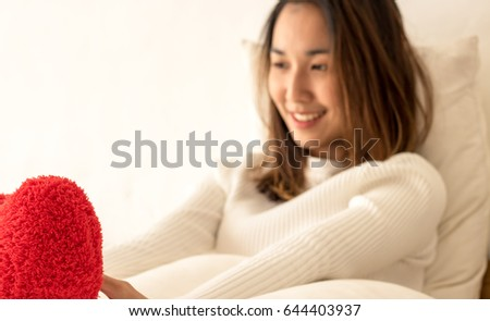 Heart pillow in hand women in the morning #644403937