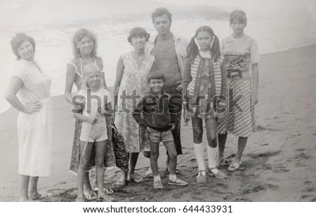 USSR, ABKHAZIA, LESELIDZE - CIRCA 1982: Vintage photo of group of people on Black sea beach in Abkhazia, USSR #644433931