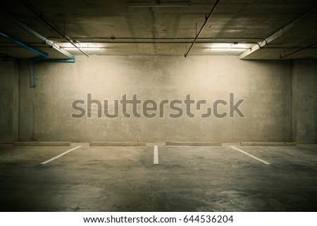 Parking garage department store interior with blank billboard. #644536204