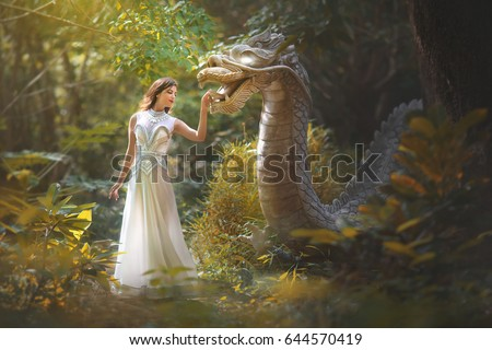 Fairy tale of a girl with a dragon in the forest #644570419