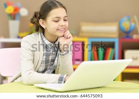 Teenage girl using a laptop #644575093