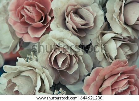 Silk dusty pale pink flowers background.