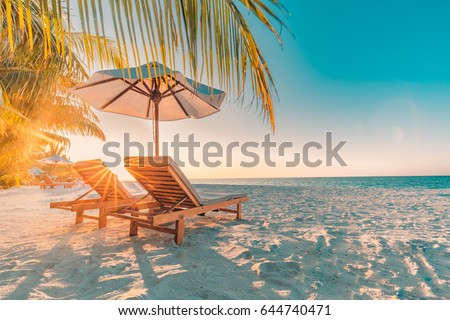 Perfect sunset beach. Idyllic tropical beach landscape for background or wallpaper. Design of summer vacation holiday concept. #644740471