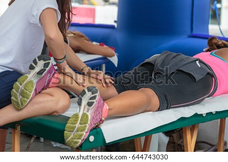 Athlete's Calf Muscle Professional Massage Treatment after Sport Workout: Fitness and Wellness #644743030