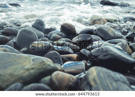 rock seaside shore with black round stone on the island #644793613