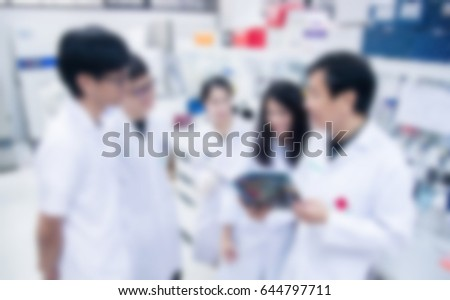 blurred background Laboratory and scientist working at chemistry laboratory, science concept. #644797711