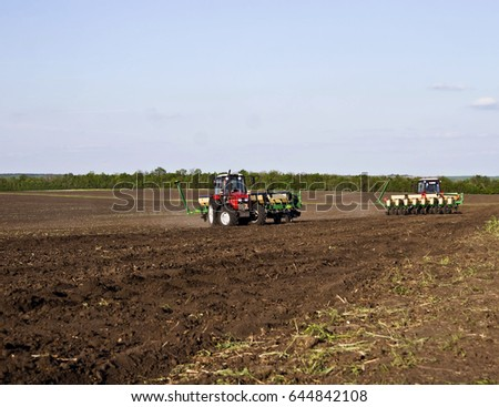 May 22, 2017:Two tractors with plows raspushivayut the ground in a field in the Ukrainian village Pisitsely May 22, 2017 #644842108