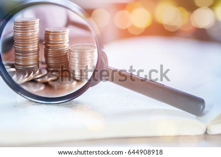 double exposure business concept with magnifying glass zoom focus on coins idea for finance,stock and saving background  #644908918