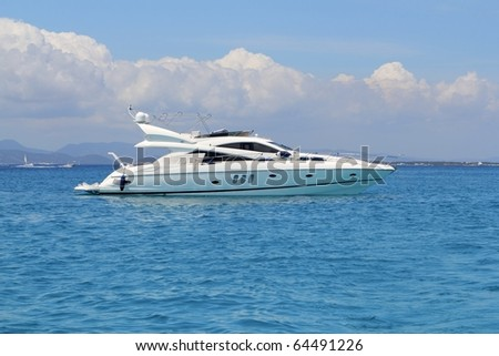 luxury yacht in turquoise Illetes Formentera mediterranean sea Balearic Islands #64491226