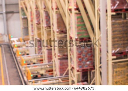 blurred image of shelf in modern distribution warehouse or storrhouse.defocused background of in dustrial warehouse interior aisle.inventary,hypermarket wholesale concept. #644982673