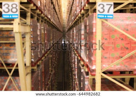 blurred image of shelf in modern distribution warehouse or storehouse.defocused background of in dustrial warehouse interior aisle.inventary,hypermarket wholesale concept. #644982682