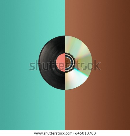 Close up of a cd and partial vinyl record