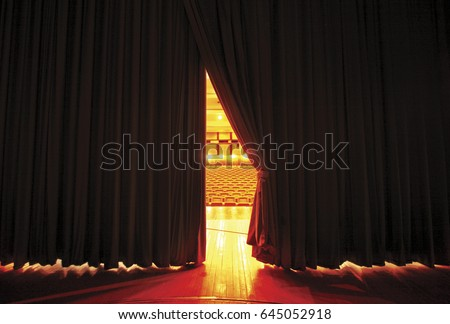 Theater seats through curtains.. behind scene Royalty-Free Stock Photo #645052918