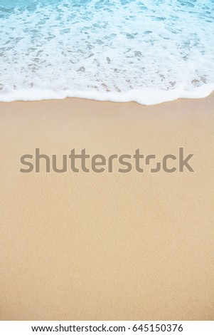 Soft blue sea wave on sandy beach background #645150376