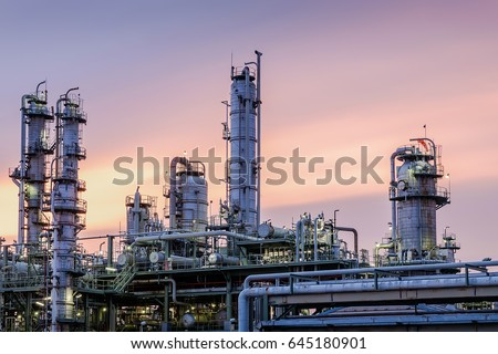 Distillation tower in factory on sky sunset background, Closeup of equipment in gas refinery plant #645180901