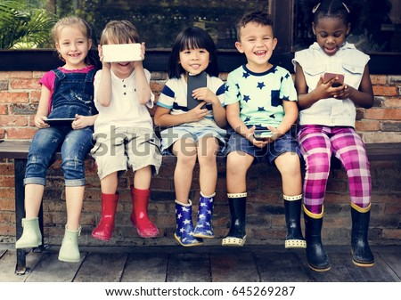 Group of Diverse Kids Using Mobile Phone Device Together #645269287