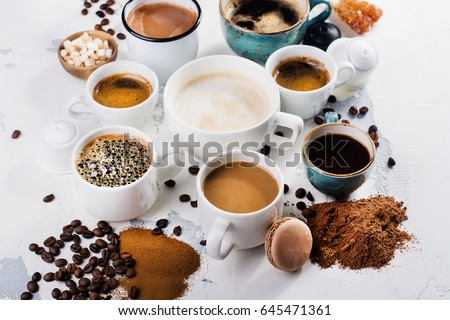 Variety of coffee in ceramic cups. Flat lay style. Time for coffee concept. Space for text #645471361